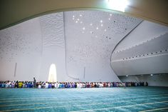 "mosque in Education City, Qatar: ""A unique feature is the lighting which are emitted from triangular openings of different sizes. For worshipers, it is as though they are praying under the stars!"""