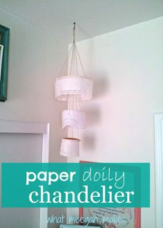 Make a paper doily chandelier with paper doilies and embroidery hoops!!  meeganmakes.com  #michaelscrafts #dollartree #joanns