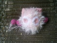 This is Masha the cute, little, pink, fluffy…robot. He's from the Anime/Manga Tokyo Mew Mew. He helps Ichigo by sensing aliens!