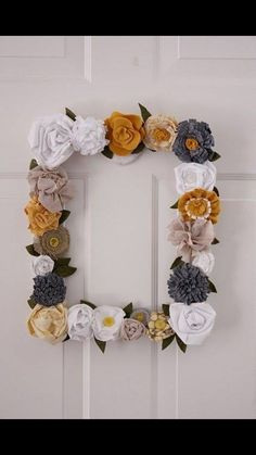I am in love with grey and mustard yellow right now. Fabric Flower Frame Wreath {a wreath}With an old frame and some scraps of fabric, you too can make this gorgeous spring wreath!View This Tutorial Felt Flowers, Diy Flowers, Fabric Flowers, Paper Flowers, Flower Diy, Crocheted Flowers, Cloth Flowers, Flower Ideas, Handmade Flowers