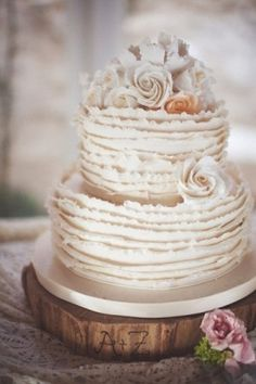 Shabby chic ruffle cake -so cute to have the initials carved on wood base