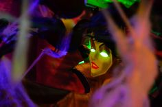 """Scary Party setup """"Maleficent Theme"""" with """"glow-in-the-dark"""" decoration features."""