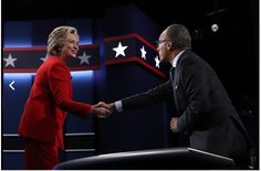 Headline: Debate 1 Slideshow Sept. 26, 2016 Hillary Clinton greets NBC's Lester Holt before the start of the debate. Justin Sullivan/Getty Images