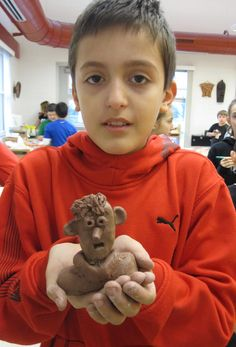 Clay Portrait Bust in terra cotta clay.