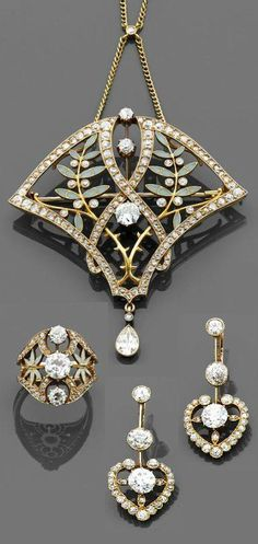 An Art Nouveau gold, enamel and diamond parure, by Masriera. Consists of a pendant with olive branch motifs, decorated with enamel, within a gold frame set with brilliant- and rose-cut diamonds, suspending a pear-shaped diamond, accompanied by a similarly designed ring, centring a brilliant-cut diamond, and a pair of heart shaped ear pendants, each set with brilliant-cut diamonds, mounted in gold.