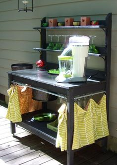 Got this idea from Southern Living magazine. We got plans for a potting bench online and turned it into an outdoor beverage center. It has a built-in ice bucket, wine glass rack and bottle opener. It is on casters so we can move it around and store it inside.