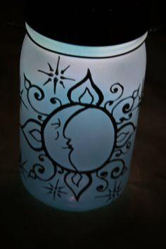 Hanging Mason Jar Solar Light Lantern, tinted a frosty sky blue, Sun and Moon face