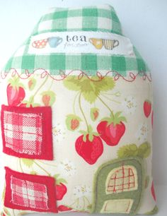 lovely fabric house. Cute as a door stopper.