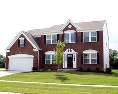 dark red brick house with black shutters black garage door Outdoor Paint Colors, Brick Paint Colors, Exterior Paint Colors, Exterior House Colors, Black Garage Doors, Black Front Doors, Red Doors, House Shutters, Black Shutters