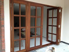 add folding french door from kitchen to deck