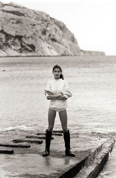 i want to wear this outfit every day.  classic fisherman sweater, swimsuit, wellies Laetitia Casta