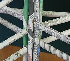 Rolled newspaper structures. Including steps to make newspaper rolls.