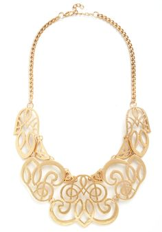 Twice Gold Tales Necklace. You love spinning stories - your words twisting and swirling like the gold details of this bib necklace. #gold #modcloth