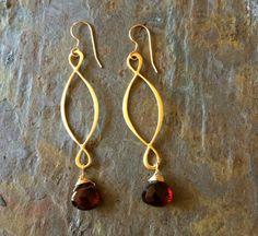 Gold filled infinity hoop earrings with wire wrapped garnet briolette gemstones