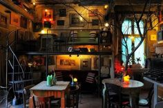 Kitschy and cozy. I'd love to sink down on that couch with a steaming mug of cider just in time for an open mic show