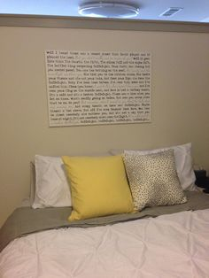 Large Word art with lyrics hung over your bed.