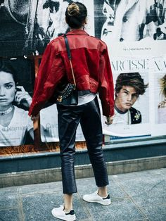 The 1980s fashion trend can be seen on the streets via oversized leather jackets—especially with shoulder pads.