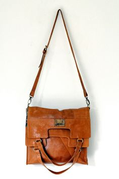MI-VIDA. Fold over leather bag / cross body bag. Available in different leather colors.. $210.00, via Etsy.