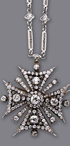An antique diamond pendant-brooch and chain, circa 1880 designed as a Maltese cross, set throughout with old European, old mine and rose-cut diamonds; suspended from an old European-cut diamond link chain (chain of slightly later date); estimated total diamond weight: 4.50 carats; pendant mounted in silver-topped fourteen karat white gold; chain mounted in platinum; length: 14 3/4in.