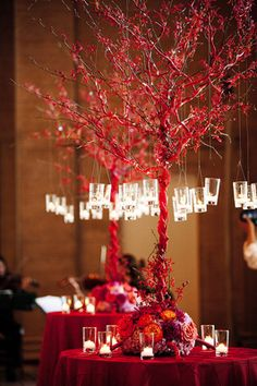 Red branch centerpiece for a fall wedding {Photo by Geoff White Photography}