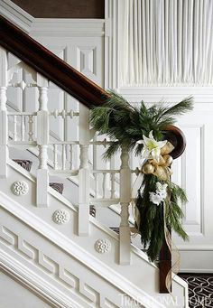 This gorgeous staircase only requires some greens, satin ribbon and a touch of gold to dres it up for the Holidays.