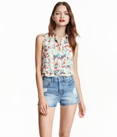 H&M Sleeveless Viscose Blouse (White/Small Floral) $12.99. Sleeveless blouse in soft, woven viscose fabric with a narrow collar. Buttons at front, chest pocket, and high slits at sides. Slightly longer at back.