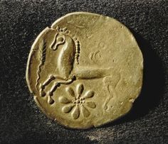 Celtic Coin / Horse and Sun /  c 1st century BC Reverse of a gold coin of the Mediomatrics (?) from northern Gaul. Diameter 2.4cm. Milan, Castello Sforzesco
