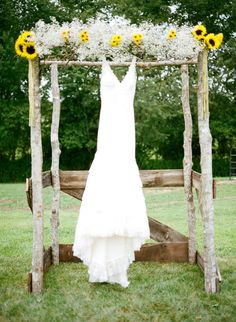 super cute wedding alter decorated withsunflower and baby's breath http://www.weddingchicks.com/2014/03/13/homespun-antique-farm-wedding/