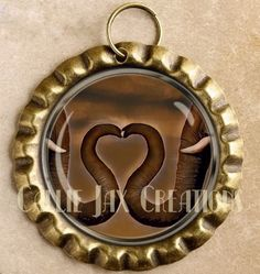 Bottle cap Pendant with Original Artwork. Elephant trunks love. Great for purse charms, day planner charms, keychain charms and zipper pulls.