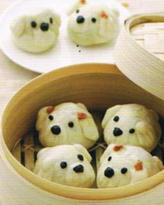 Japanese steamed dumplings (nikuman) shaped like puppies. I don't know whether I could actually bite into one of those cute little puppy faces.