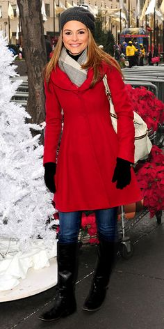 Maria Menounos spread some holiday cheer at Rockefeller Center in a festive red coat and knee-high boots.