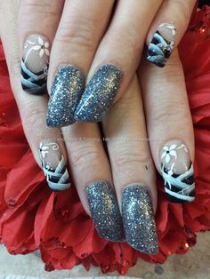 black tips with one stroke stripes and flowers and 520 crystal nails brilliant gel on lipstick nails