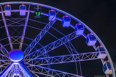 Helsinki Sky Wheel, a brand new Ferris wheel on the Katajanokka waterfront in the South Harbour. One of the gondolas is black and equipped with a transparent floor.