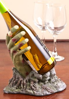 Monster Bash Wine Bottle Holder. Store your spare Chardonnay for your spooky soire in this zombie-themed bottle holder! #multi #modcloth