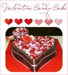 "Ahhhhhh, M&M's, KitKats and chocolate cake!  It would be a shame to cut into it!   From the Post: ""Valentine Candy cake is Darn Good Chocolate Cake filled and frosted with chocolate buttercream. Roses are gumpaste. Kitkats, M&M's and purchased ribbon. Happy Valentines Day""  SOURCE"