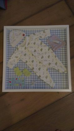 After 14 months my frame with baby's first outfit is ready!