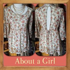 "12015) About a Girl chiffon floral top A cute twist on this floral blouse-an open back. Color is more off white with taupe/gray design and pretty peach, rose and yellow flowers. Sz small. Measures: 20"" pit to pit x 25""L. Elastic waist and ties in back. Feels like silk but is poly. Will need cami underneath. EUC. About a Girl Tops"