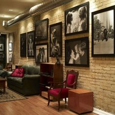 Make an exposed brick wall a place to showcase your favorite art pieces. This black and white collage looks amazing on this brick wall.