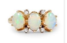 brilliantearth.hardpin.com  Three oval-shaped opals gleam with a magical shimmer of color in this Victorian-era ring from the 1890's. Four single cut diamonds sparkle alongside the opals for a truly breathtaking look (approx. 0.04 total carat weight).