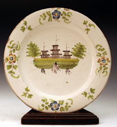 Antique English pottery delftware plate with polychrome decorations. ca.1720 (England)