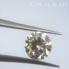 0.79 ct K color SI1 clarity Shape : Round Cut  Clarity : SI1 Color : White K Origin : Tanzania Treatment : Untreated 100% natural diamond The picture is in the same color & quality  This is nonrefundable item. This is for security issue. If you want certificate, we can send to IDL international labratory. That costs 100 dolar extra.  If you have any question, Or any spesific requirement, Or selection of any diamond lot, Just send an email : gemaddicted(at)gmail.com  Regards, Grand Bazaar…
