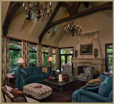 the blue of the couches is sooo striking.  love the neutral background of the walls,fireplace and ceiling