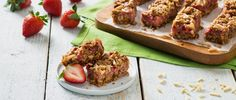 Need a sweet springtime treat? Create these Strawberry Almond Oat Bars - it's dessert with a little bit of a health twist thanks to strawberries and oats! #Dessert #Recipe #Strawberry