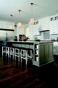 Loving this modern kitchen design. And check out the wood floors! Find these floors and more at carpetone.com