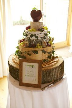 traditional wedding cakes A tower of cheese for a wedding cake. There would be the unfortunate problem of avoiding the announcement: quot;The bride and groom will now cut the cheese. Barn Wedding Cakes, Wedding Cake Designs, Cheese Wedding Cakes, Cheese Cakes, Alternative Wedding Cakes, Wedding Cake Alternatives, Cheese Tray Display, Cheese Tower, Wheel Cake