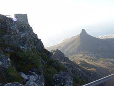 A less typical view of Lion's Head as seen from atop Table Mountain. Always take care to hold onto something when you're up high! #nature #capetown #wow