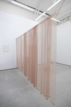 nude satin curtains and concrete floors - Caitlin Keogh (left) Super-Kamiokande, 2011; Ruth Buchanan (centre) Cast a light across it, 2012