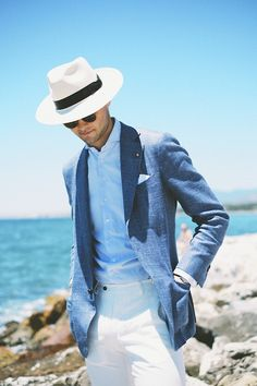 Throwback to this summer in Spain.  Suitsupply Jort jacket, Suitsupply trousers, Belisario MTM shirt, Lock and Co Hatters Panama Hat.