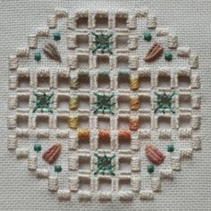 A creative little piece done in variegated fibers using hardanger and drawn thread.