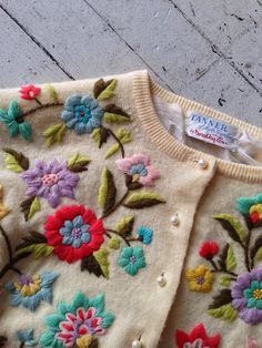 Vintage cashmere sweater with vibrant crewelwork flowers embroidered on. Love.